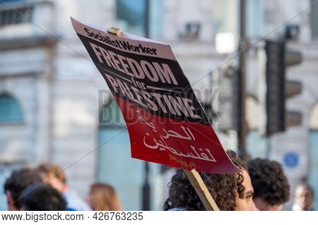 London - May 29, 2021: A Protester Holds A Freedom For Palestine Placard Sign At A Protest Rally