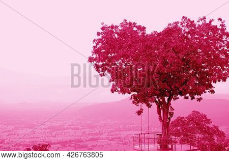 Pop Art Surreal Style Heart Shaped Tree Against Cloudy Sky In Magenta Color Tone