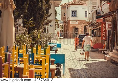 Alacati, Turkey: Sunny Street Of Small Turkish Town With Relaxing People, At Vacation Time 6 May, 20