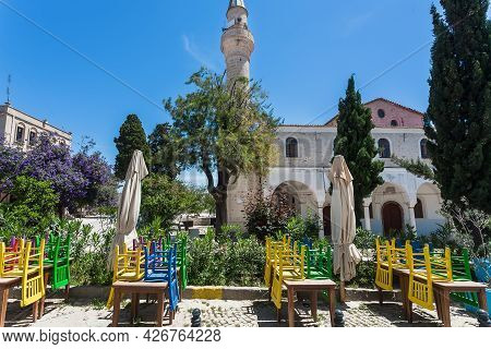 Alacati, Turkey: Siesta Time Near Town Restaurant Past Old Mosque At Sunny Street 6 May, 2021. Ayval