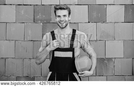 Building Construction. Man Build House. Inspecting Building. Worker Brick Wall Background. General M