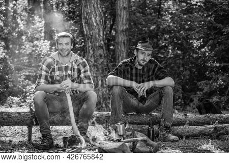 Discover Life. Adventure Concept. Hike And People. Two Men Relax At Fire. Hiking And Camping. Male F