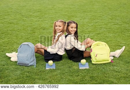 Friends Makes You Happy. School Friends Relax On Green Grass. Happy Friends Back To School. Classmat