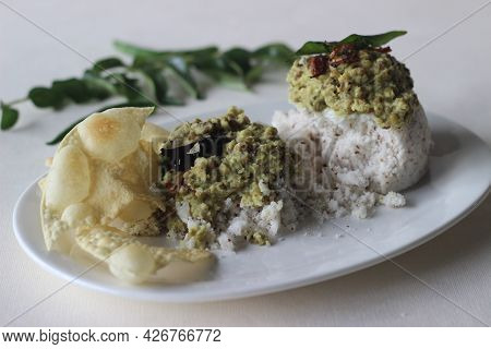 Steamed Rice Cake Served With Green Gram Curry And Papad. A Favorite Dish Of Kerala Commonly Known A