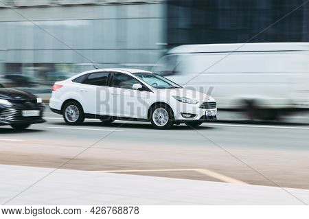 Moscow , Russia - April 2021: Ford Focus On The Road In Motion. Fast Speed Drive On City Road. Side