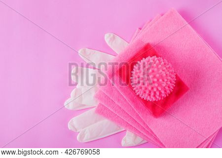 Pink Cleaning Set. Laundry Ball, Rag, Foam Rubber Sponge And Latex Gloves On Pink Background. Flat L