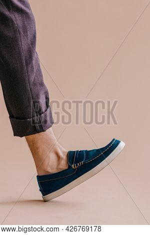 Man leg in jeans and slip-on shoe