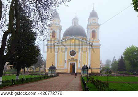 Chernivtsi, Ukraine-may 14, 2021:picturesque Foggy Landscape View Of Medieval Cathedral Of The Holy