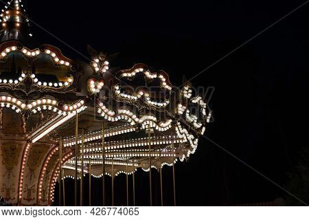 Vintage Carousel Lights In The Park, Retro Merry-go-round In The Evening In Summer.