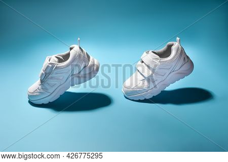 Two White Girly Flying In The Air Sneakers Simulate Walking Or Running