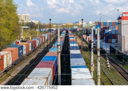 Freight Trains With Containers Near Logistic Terminal In Moscow. Colorful Containers Waiting For Loa