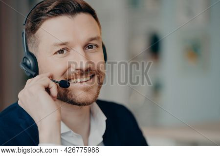 Happy Young Business Professional Or Executive Manager Wearing Suit And Headphones With Microphone S