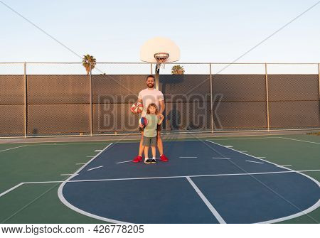 Happy Family. Dad And Kid Boy Play Basketball. Child Hold Sport Ball. Childhood And Fatherhood.