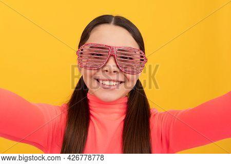 Happy Funny Kid In Glamour Eyeglasses With Rhinestones. Teen Girl Having Fun. Child In Glasses