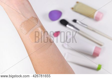 Taking Swatches Of Foundation On Lower Arm To Fight Right Skin Tone Shade
