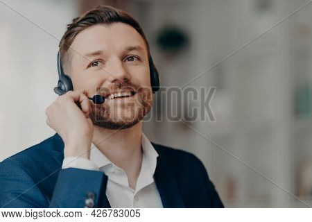 Close Up Of Happy Office Worker Handsome Male Call Center Operator Wearing Headset And Working In Of