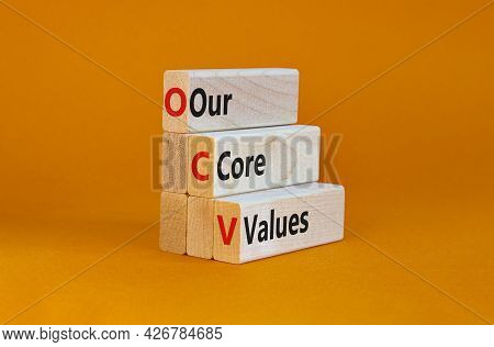 Our Core Values Symbol. Concept Words 'our Core Values' On Wooden Blocks On A Beautiful Orange Backg