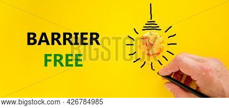 Barrier Free Symbol. Businessman Writing Words 'barrier Free', Isolated On Beautiful Yellow Backgrou