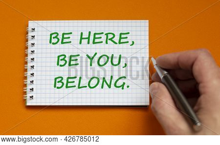 You Belong Here Symbol. Businessman Writing Words Be Here, Be You, Belong On White Note. Beautiful O