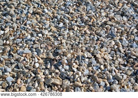 Natural Gray Granite Chippings. Crushed Stones Background Top View. Macro Photo Of Broken Stone Or C