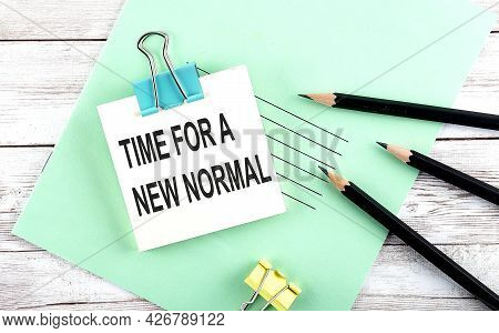 Text Time For A New Normal On The Short Note With Pencils On Wooden Background