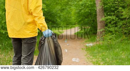 Banner Volunteer Hands Picks Up A Plastic Trash Grass In Park. Eco Friendly. Volunteer Cleaning Up G