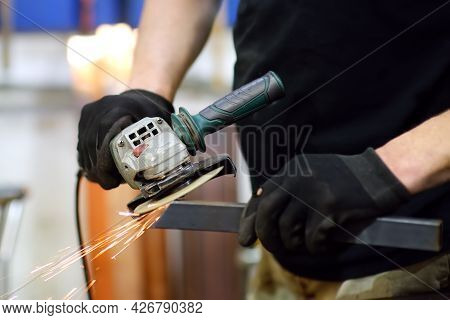 Metalwork Craftsman Cutting Metal With Grinder Tools. Worker Man In Protection Gloves And Glasses Wo