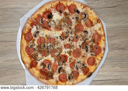 Overhead View Of Melted Cheeses Covers This Mushroom And Pepperoni Pizza With The Crispy Crust Cooke