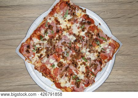 Overhead View Of Square Cut Sicilian Pizza Covered In Delicious Toppings And Melted Cheese For This