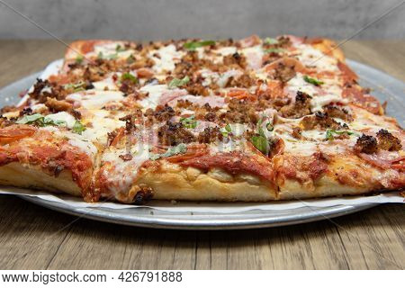 Square Cut Sicilian Pizza Covered In Delicious Toppings And Melted Cheese For This Meal.