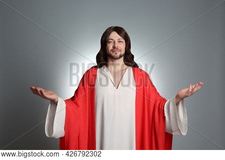 Jesus Christ With Outstretched Arms On Light Grey Background