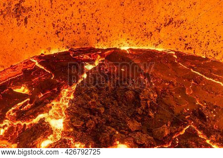 The Surface Of A Hot Liquid Slag In A Metallurgical Ladle. Thick Crust Covered With Trash Net. Freez