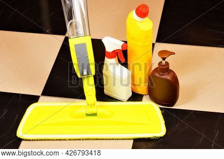 Cleaning The Tile Floor Surface From Dirt With A Cleaning Mop And Detergents. Sanitary Restoration O
