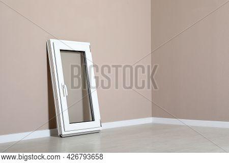 Modern Single Casement Window Near Beige Wall Indoors, Space For Text