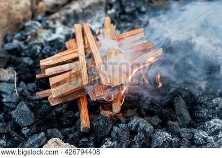 Starting The Camp Fire With Kindling. Camping Life
