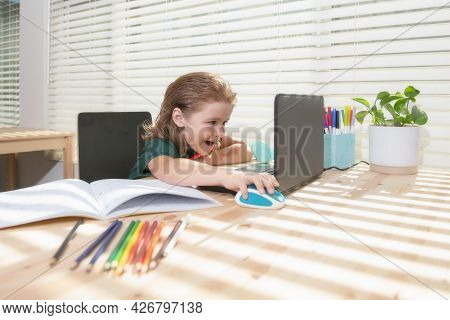 Education And Distance Learning For Kids, Homeschooling. School Child Watching Online Education Clas