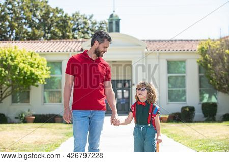 School Boy Going To School With Father.