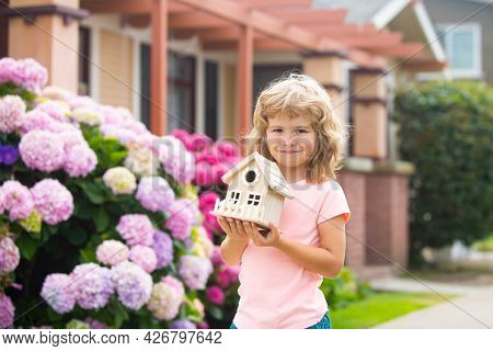 Kid Child Dreaming Of New Home. Happy Boy Holding Dream House In Their Hands, Real Estate And Home I