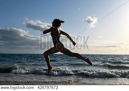Woman Running Silhouette. Female Weight Loss Concept.