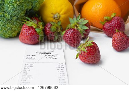A Shopping Receipt Bill With Variety Of Colorful Fresh Fruits And Vegetables. Raw Organic Healthy Fo