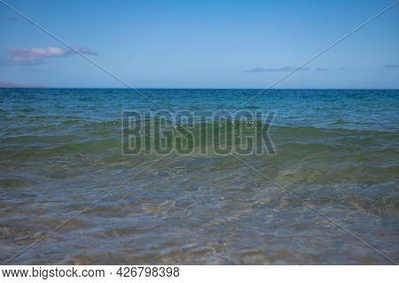 Idyllic Scene Beach In Thailand. Tropical Blue Sea And A Sand Beach Background.