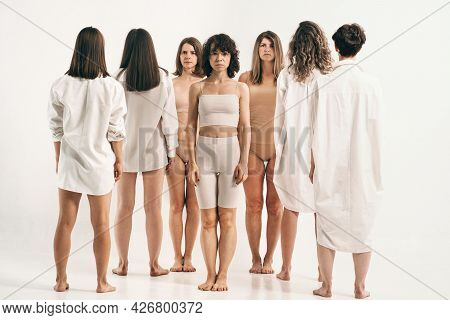 Girls With Different Types Of Figures Stand. Study Of Female Psychology. Connection Between People.