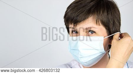 Pandemic End. The Doctor Is Wearing Or Removing The Mask. Stop Covid-19. End Coronavirus. End Lockdo