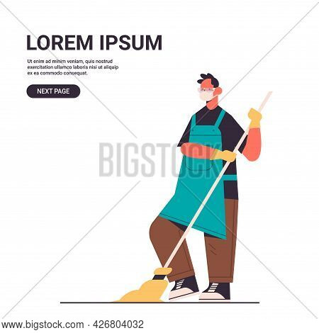Man Janitor In Mask Washing Floor With Mop Disinfecting Coronavirus Cells To Prevent Covid-19 Pandem