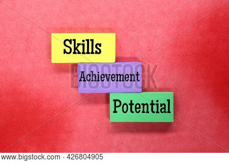 Colored Cubes With The Words Skills, Achievement And Potential