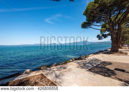 Lago Di Garda. The Lake Garda View From The Small Town Of Lazise, Tourist Resort On The Coast, Veron