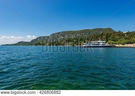 Coastline In Front Of The Small Garda Town, Tourist Resort On The Coast Of Lake Garda (lago Di Garda