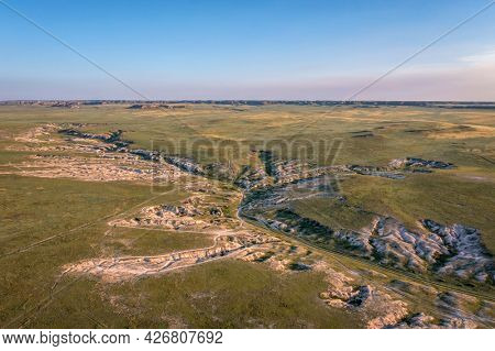 morning light over arroyo and badlands in Pawnee National Grassland in northern Colorado, early summer scenery aerial view of Main Draw area