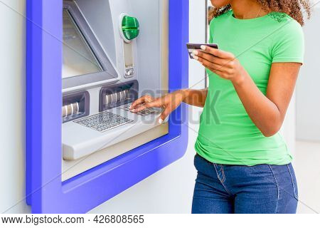 One Black Woman Withdrawing Money At An Atm