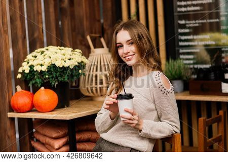 Very Beautiful Young Woman, Sit In Cafe And Drink Coffee Or Tea, Street Front View